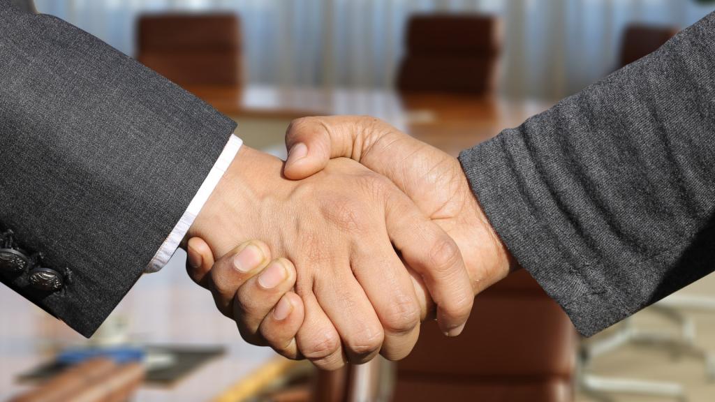 coads-shaking-hands-business-meeting